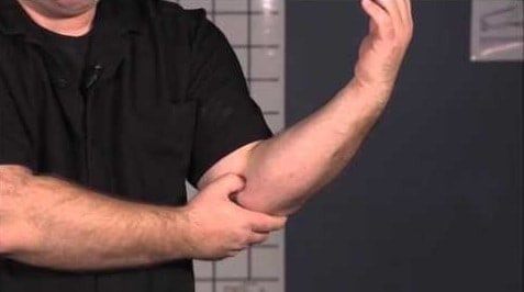 massage treatment for golfer's elbow