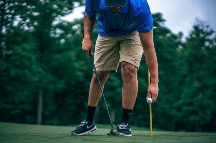 back pain flexed posture golf