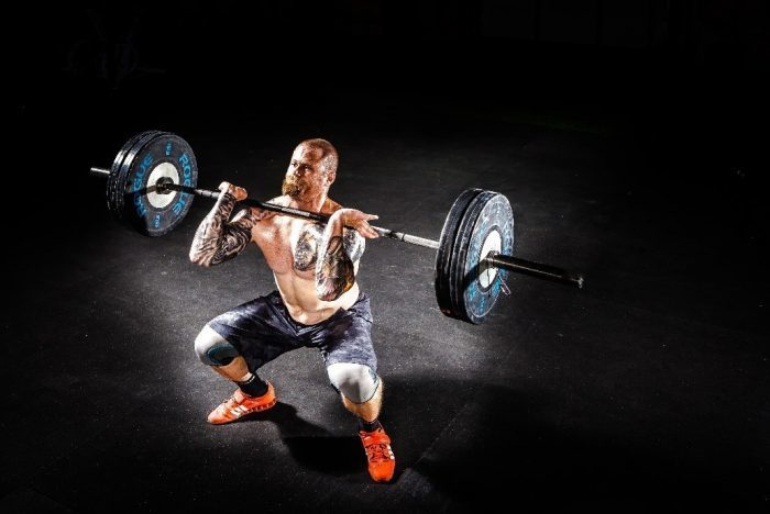 back pain lifting barbell